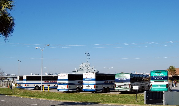 Six busses in the Patriots Point parking lot on 06 February.