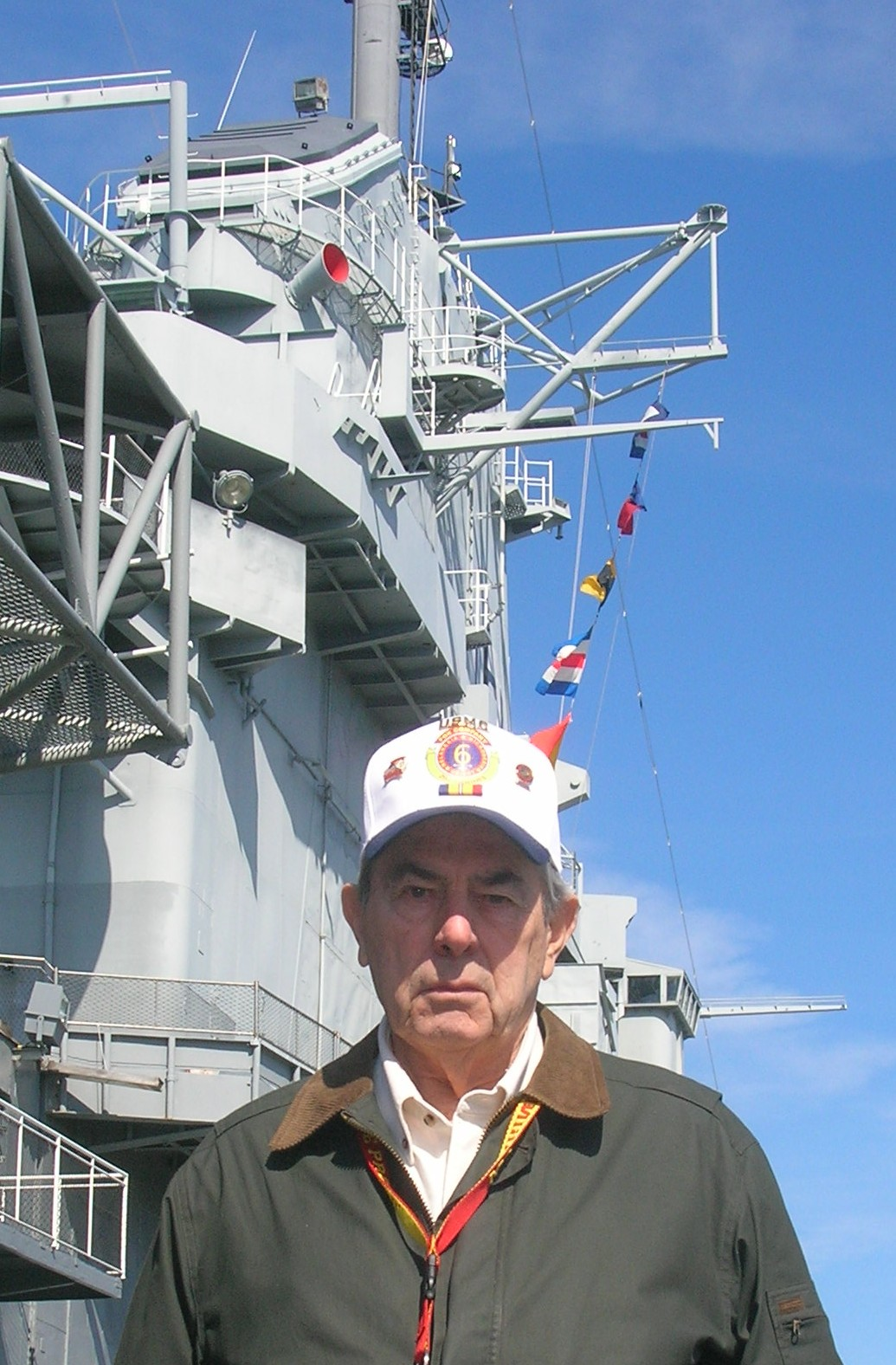 Volunteer Dick Whitaker under signal flags on the USS Yorktown, CV-10.