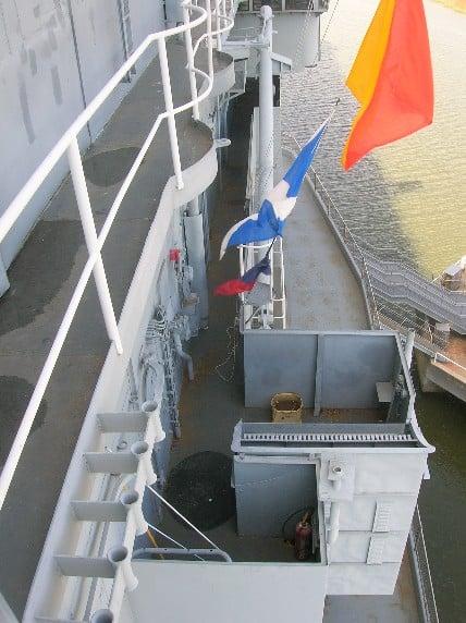 Bomb impact spot on the O-5 level (dark circle below the Echo flag).
