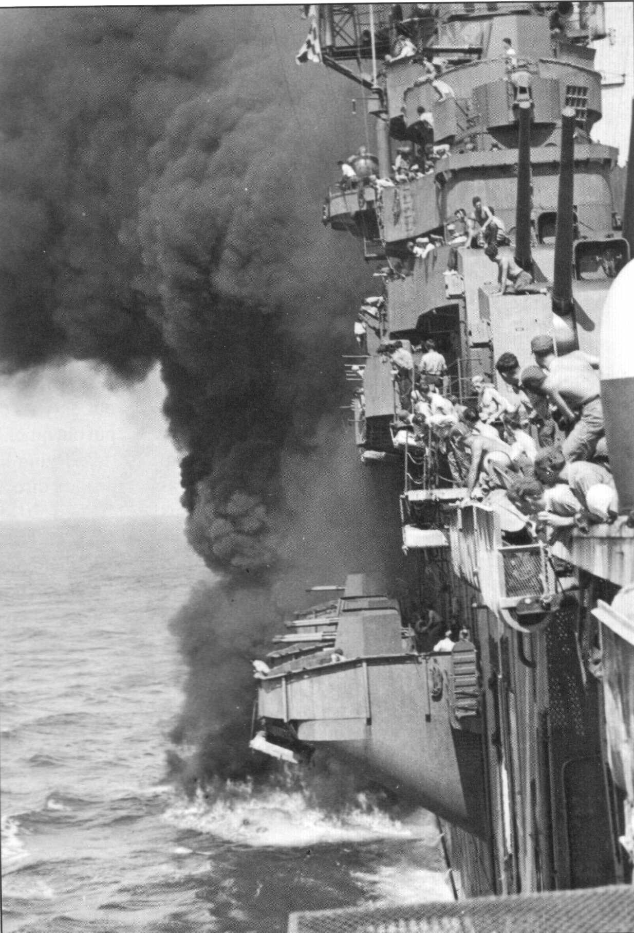 USS Yorktown (CV-10) hit by Japanese bomb at 1507, 18 March 1945 off Okinawa.