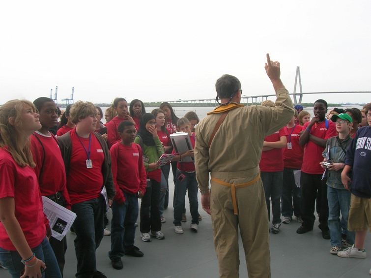 On the flight deck of USS Yorktown (new Cooper River bridge in distance) ELW students learn about aircraft carrier technologies that helped us win the Pacific war.