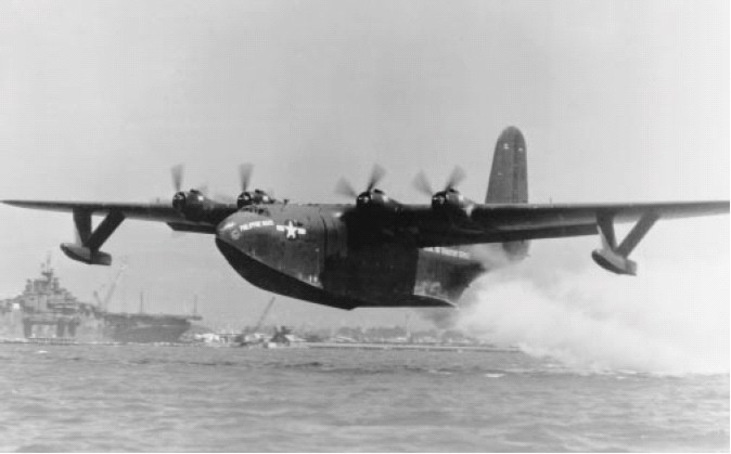 Martin Mars aircraft on takeoff (note the Essex carrier in the background).