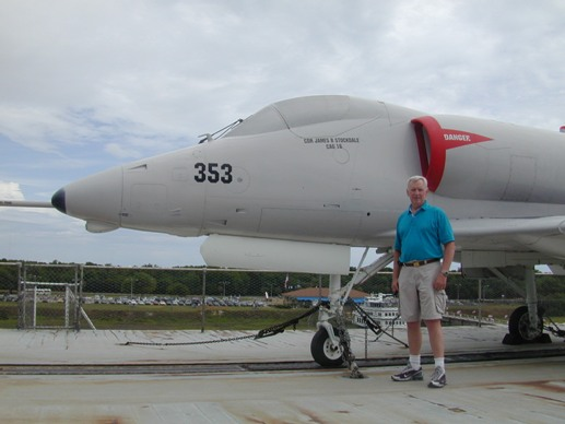 Lieutenant Colonel John Souders USMC (Ret.) next to the A-4 Skyhawk.