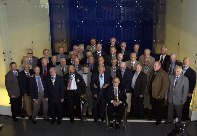 Medal of Honor recipients at the MOH museum opening in May 2007. John Finn is in the front row, first standing on the left hand side of the wheelchair.