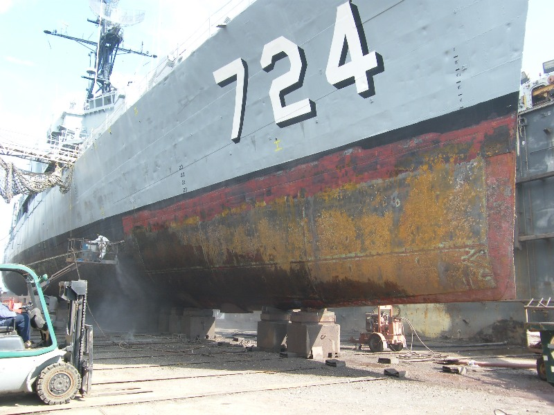 USS Laffey on blocks in dry dock and being prepped for serious work.