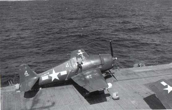 F-6F-5E fighter on USS Sangamon in April 1945 (notice radar pod, white, under the wingtip).