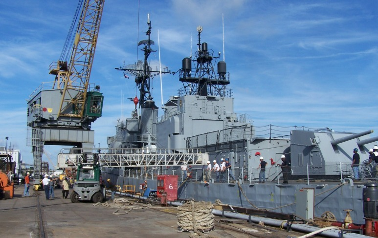 Gangway being attached from Laffey to pier at Detyen's shipyard.