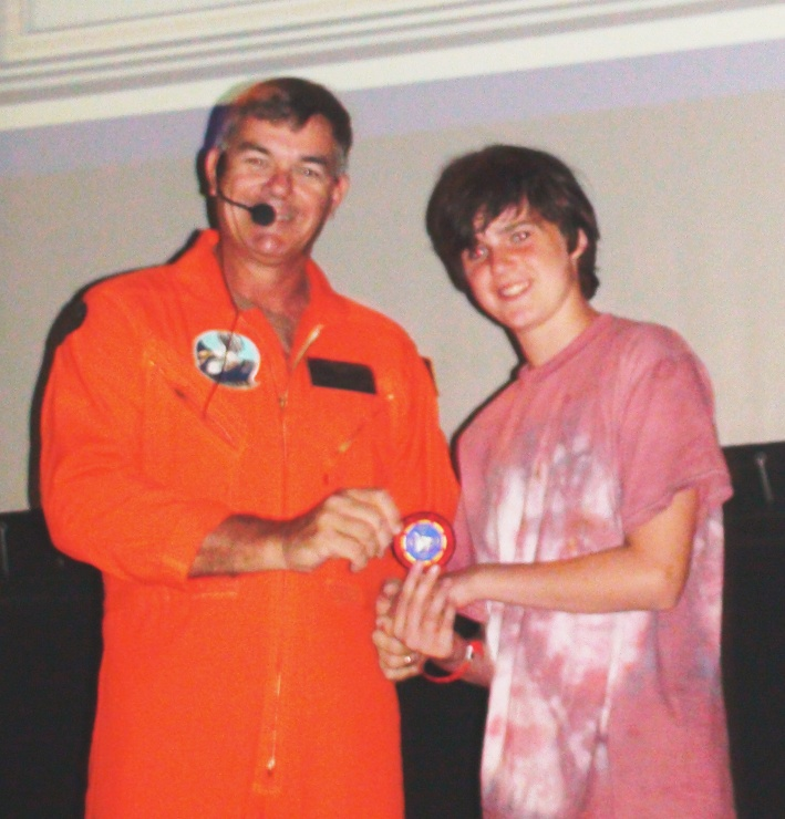 """Life Scout Earl Wells, Troop 757 Huntsville, Alabama, is awarded the coveted """"Top Gun"""" patch on USS Yorktown, CV-10."""