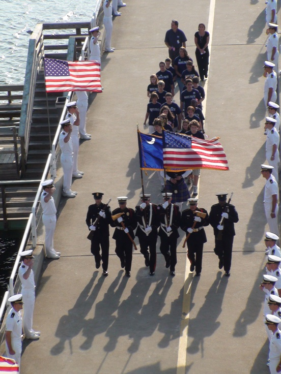 Color guard and Moultrie Middle school 8th graders process down the pier to Yorktown.