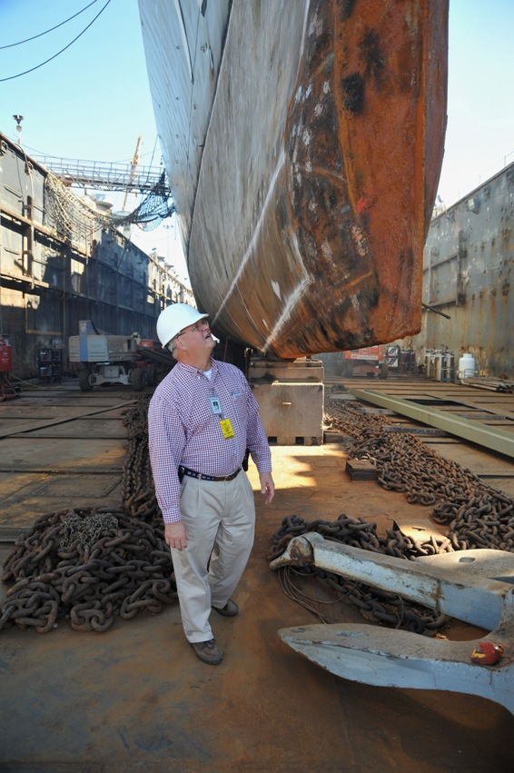 Executive director Dick Trammel inspects repairs on the bow of Laffey.