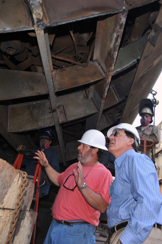 Senator McConnell closely inspects the work on Laffey's hull.