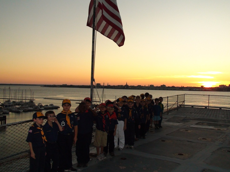 Cubs under the national flag as the sun sets on historic Charleston.