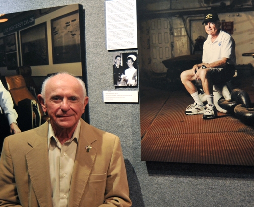 "Patriots Point volunteer Arnie Stein next to his portrait from ""The Veterans of the Fighting Lady"" exhibit last November."