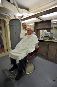 Elite Barbershop owner Joe Roberts is pictured standing with Town of Mount Pleasant Mayor Billy Swails.