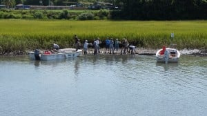 Patriots Point employees and volunteers work with the SC DNR to build an oyster reef near the USS Laffey